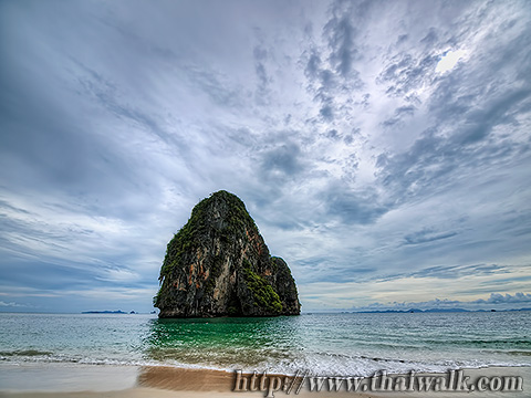 The rock in the sea of Phra Nang Beach on a cloudy sky day