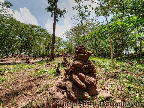 Phanom Rung - the walkway (Thai people like piling up small stones)
