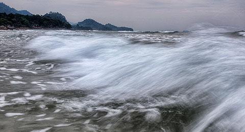 White Sand Beach under a cloudy sky